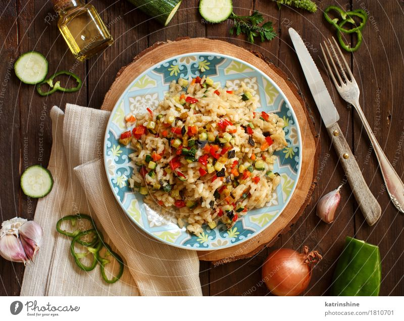 Risotto with vegetables Vegetable Grain Cooking oil Nutrition Lunch Dinner Vegetarian diet Diet Italian Food Plate Bottle Fork Wood Delicious cook Culinary