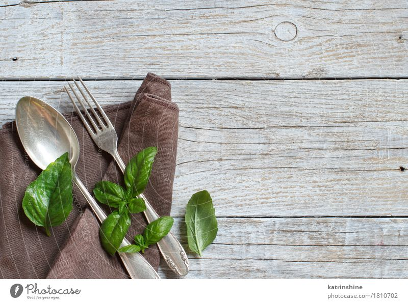 Vintage fork and knife on a napkin Old Green Dark Feasts & Celebrations Brown Design Bright Arrangement Retro Table Places Herbs and spices Dinner Shabby