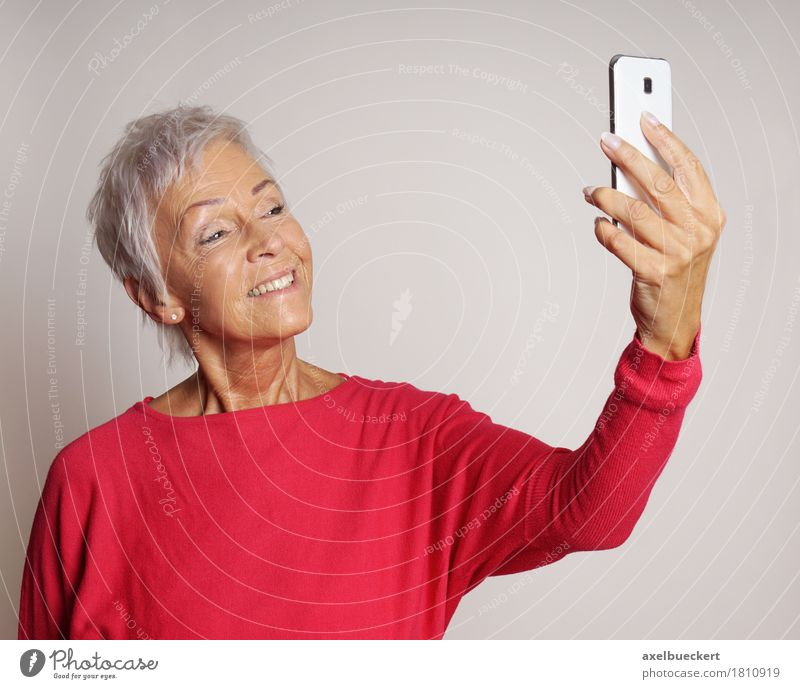 mature woman taking a selfie with smartphone Human being Woman Old Adults Senior citizen Lifestyle Modern Technology 60 years and older Happiness Smiling Photography Female senior Telephone Hip & trendy Cellphone