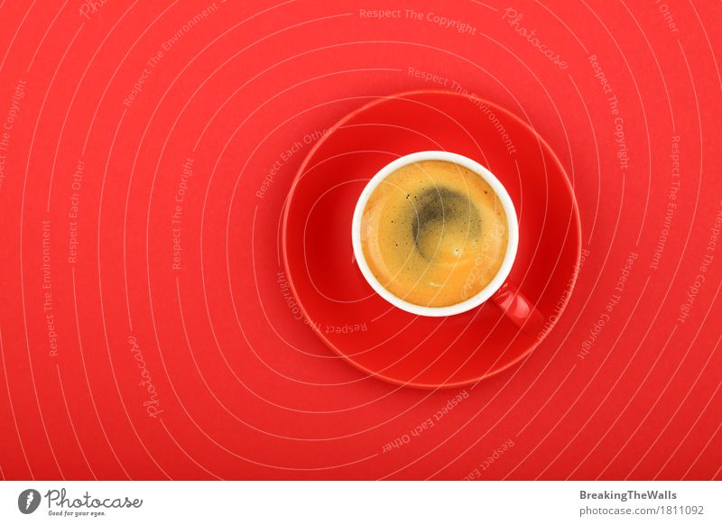 Espresso coffee in red cup with saucer on red, top view Colour Healthy Eating Red Power Vantage point To enjoy Energy Might Beverage Coffee Strong Breakfast Top