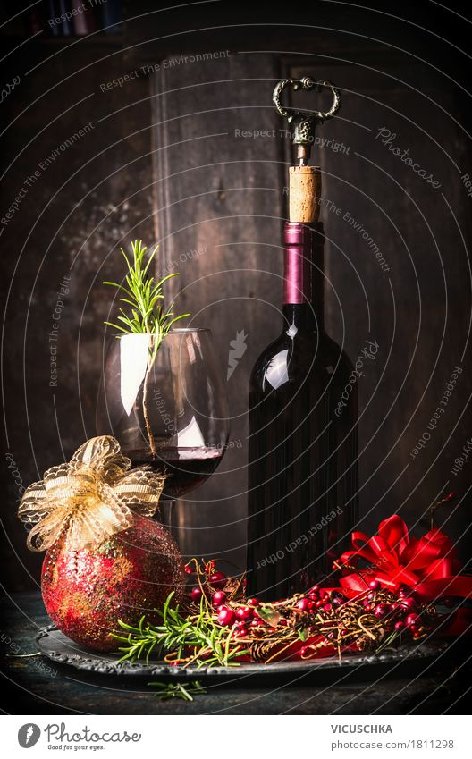 Red wine with festive Christmas decoration Banquet Beverage Drinking Wine Bottle Glass Luxury Style Design Joy Winter Living or residing Interior design