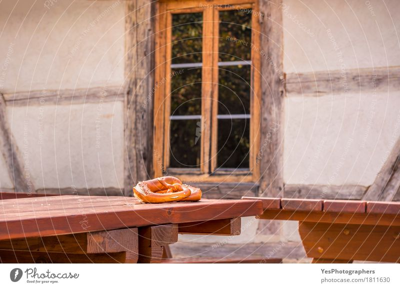 Pretzel on table in a rustic German decor House (Residential Structure) Architecture Germany Brown Facade Design Copy Space Gold Europe Table Culture Idea