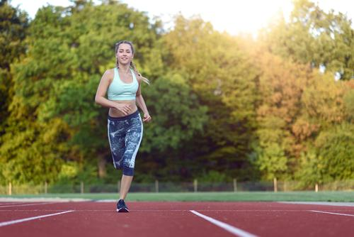 Female athlete training for a race Happy Face Sports Racecourse Woman Adults 1 Human being 18 - 30 years Youth (Young adults) Blonde Fitness Smiling Power