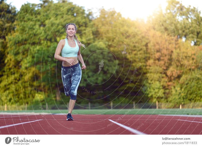 Female athlete training for a race Human being Woman Youth (Young adults) 18 - 30 years Face Adults Sports Happy Copy Space Blonde Power Smiling Fitness Racecourse Practice Explosive