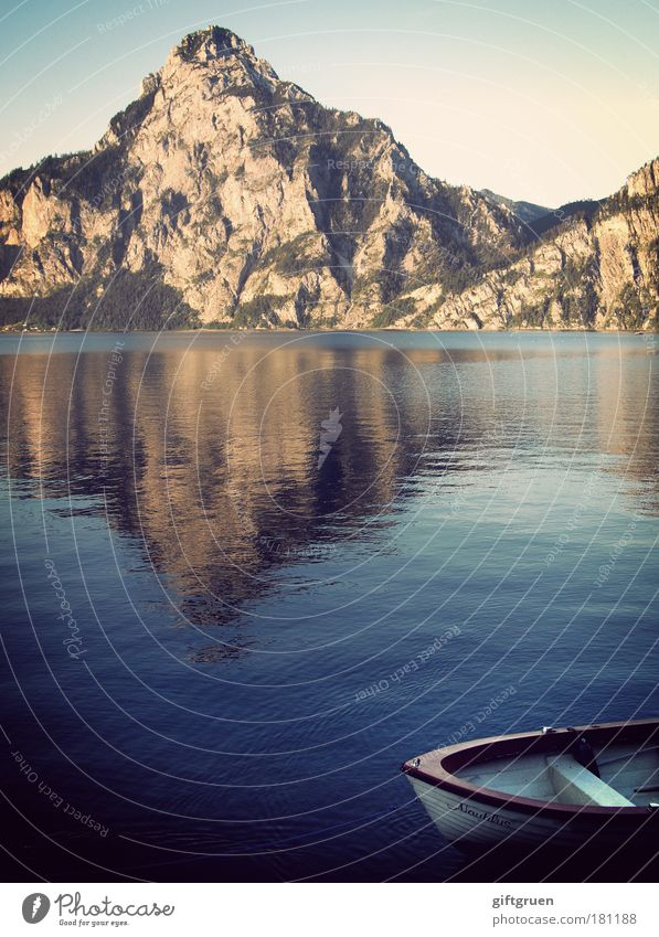 nautilus Colour photo Exterior shot Deserted Environment Nature Water Sky Lake Esthetic Tourism Mountain Mountaineering Body of water boat Rowboat Motorboat