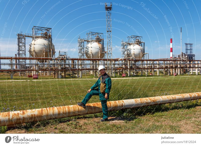 Refinery worker on petrochemical factory Human being Woman Plant Landscape Adults Environment Metal Technology 45 - 60 years Europe Energy Industry