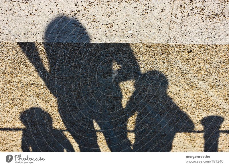 Human being Child Man Black Adults Sand Warmth Group Family & Relations Brown Concrete Observe Tracks Sign Joie de vivre (Vitality) To enjoy