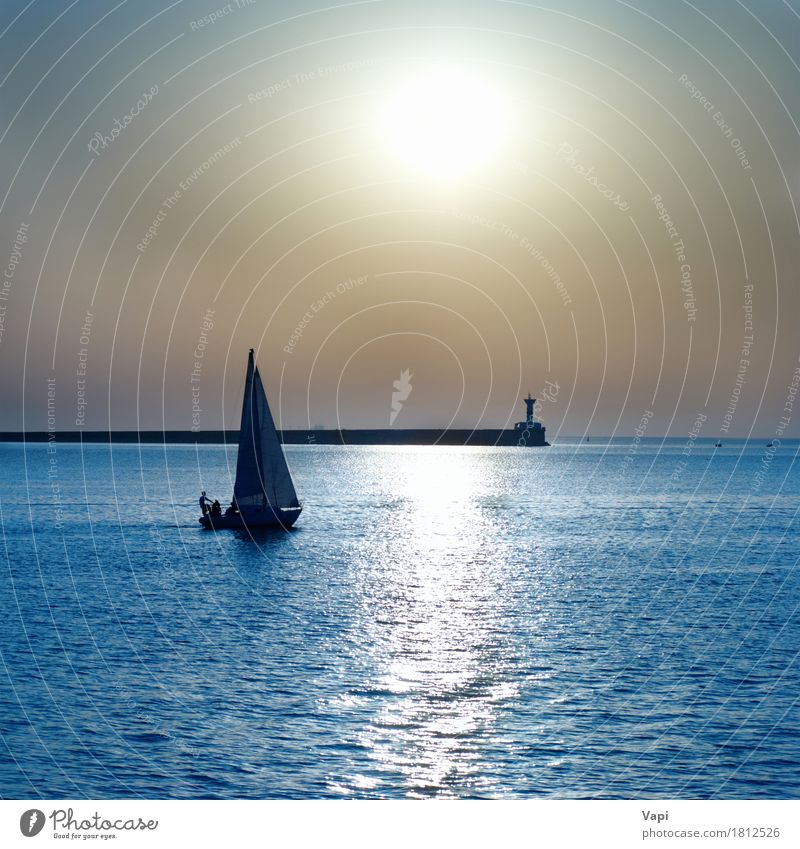 Sail boat against sea sunset Sky Nature Vacation & Travel Blue Colour Summer Water White Sun Ocean Landscape Relaxation Beach Yellow Lanes & trails Sports
