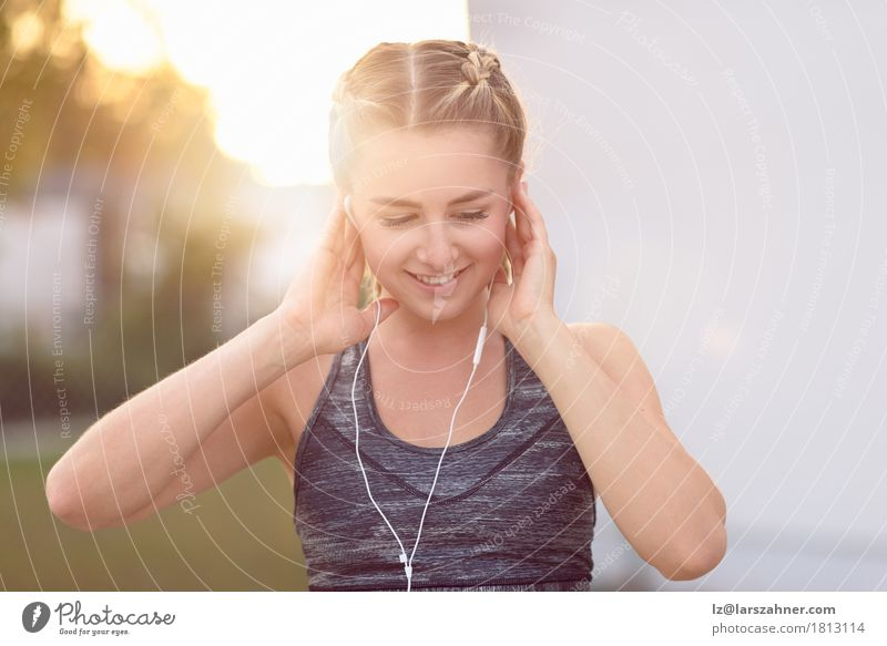 Attractive young woman with a lovely smile Human being Woman Youth (Young adults) Summer Beautiful 18 - 30 years Face Adults Lifestyle Happy Copy Space Blonde Music Smiling Fitness Athletic