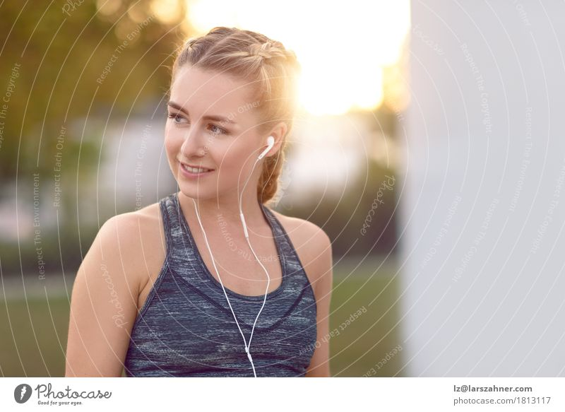 Attractive young woman with earphones listening to music Lifestyle Happy Beautiful Face Summer Music Woman Adults 1 Human being 18 - 30 years