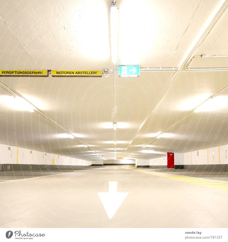 Turn off the engines! Town Deserted Parking garage Manmade structures Building Architecture Street Sign Road sign Line Arrow Stripe Emergency exit Red Bright