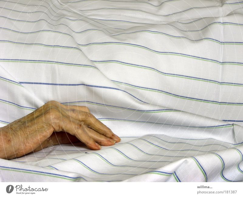 Hand of a senior citizen on a sickbed in a nursing home age Illness Health care Nursing Duvet Retirement pension Home for the elderly Care of the elderly