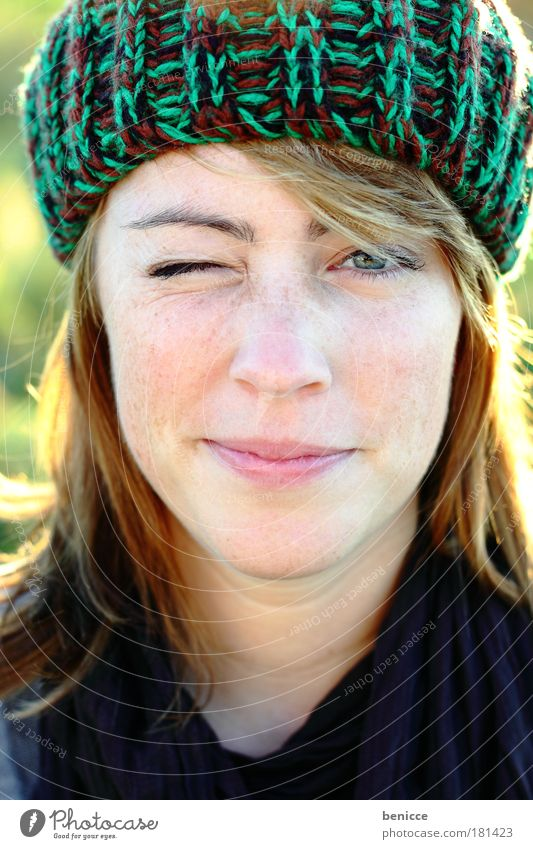 See ya ! Woman Human being Youth (Young adults) Europe Freckles Cap Woolen hat Autumn Winter Portrait photograph Wink Eyes Close-up Laughter Smiling Joy Nature