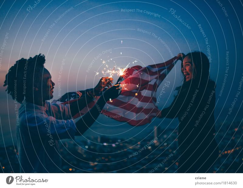 African man and Girl celebrating with USA flag and sparkler Human being Woman City Joy Adults Lifestyle Laughter Freedom Feasts & Celebrations Friendship Happiness USA Smiling Flag Applause Sparkler