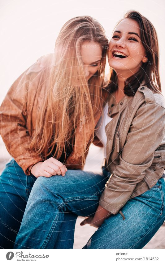 Best friends having fun together on the beach laughing Lifestyle Joy Happy Relaxation Freedom Sun Beach Young woman Youth (Young adults) Couple Partner Adults 2