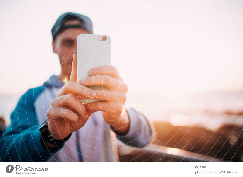 Young adult man taking photo with smart phone outdoor Human being Youth (Young adults) Man Hand Young man Ocean Beach 18 - 30 years Adults Lifestyle Copy Space 13 - 18 years Modern Communicate Technology Telephone