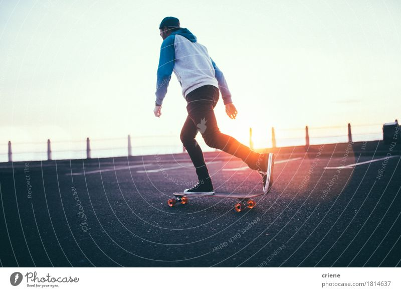 Hipster boy rolling with long board on promenade in sunset Human being Youth (Young adults) Man Young man Relaxation Adults Street Sports Lifestyle Leisure and hobbies Transport Modern Action Happiness Hip & trendy Skateboard