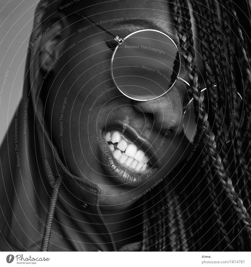 Universal wisdom Feminine Mouth Teeth 1 Human being Coat Rain jacket Sunglasses Black-haired Long-haired Dreadlocks Smiling Aggression Threat Brash Rebellious