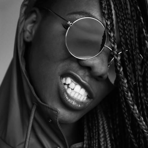 Universal wisdom Feminine Mouth Teeth 1 Human being Coat Rain jacket Sunglasses Black-haired Long-haired Dreadlocks Smiling Aggression Threat Brash Rebellious