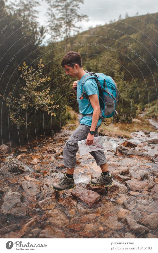 Boy going across a mountain stream Human being Nature Vacation & Travel Youth (Young adults) Summer Relaxation Loneliness Mountain Natural Boy (child) Freedom