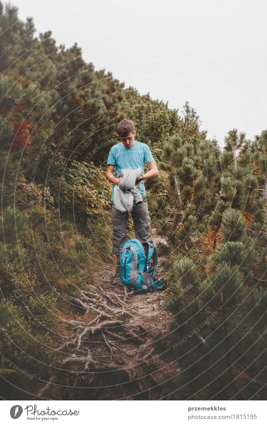 Boy packing his clothes to backpack on trail Human being Nature Vacation & Travel Summer Loneliness Mountain Lifestyle Boy (child) Freedom Copy Space Hiking