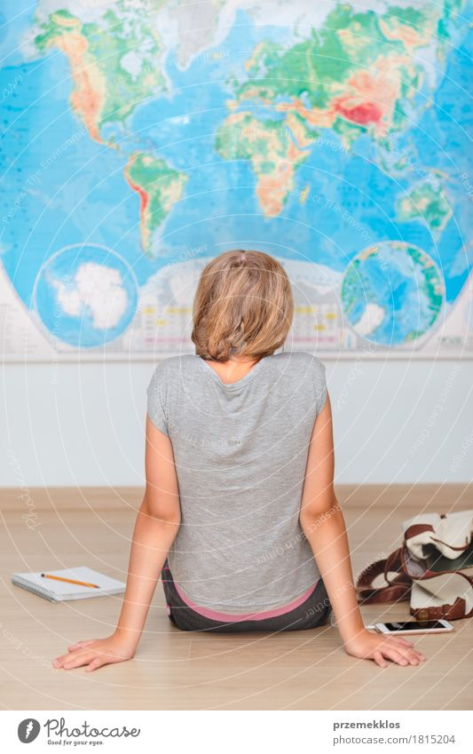 Girl sitting by the map in classroom Human being Lifestyle Boy (child) School Think Study Education University & College student Cellphone Map Pen Vertical Resolve Schoolchild Classroom Caucasian