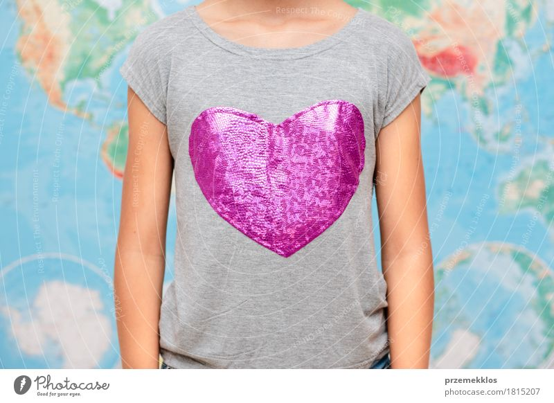 Girl with heart shape on t-shirt with map in the background 1 Human being 13 - 18 years Youth (Young adults) T-shirt Heart Globe Love Free Friendliness