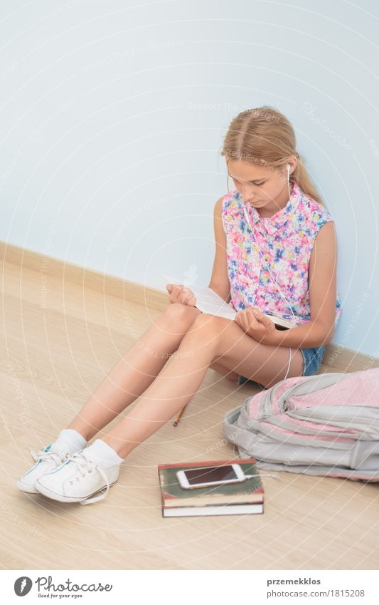 Schoolgirl reading a book in classroom Human being Girl Lifestyle School Think Sit Book Academic studies Reading Education University & College student Cellphone Pen Vertical Resolve Schoolchild