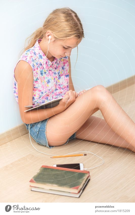 Schoolgirl reading a book in classroom Human being Youth (Young adults) Girl Lifestyle School Think 13 - 18 years Sit Book Academic studies Reading Education University & College student Cellphone Pen Vertical