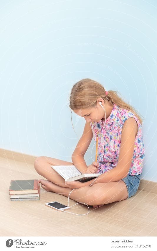 Schoolgirl reading a book in classroom Human being Youth (Young adults) Girl Lifestyle School Think 13 - 18 years Sit Book Academic studies Reading Education Write Pen Workplace Tool