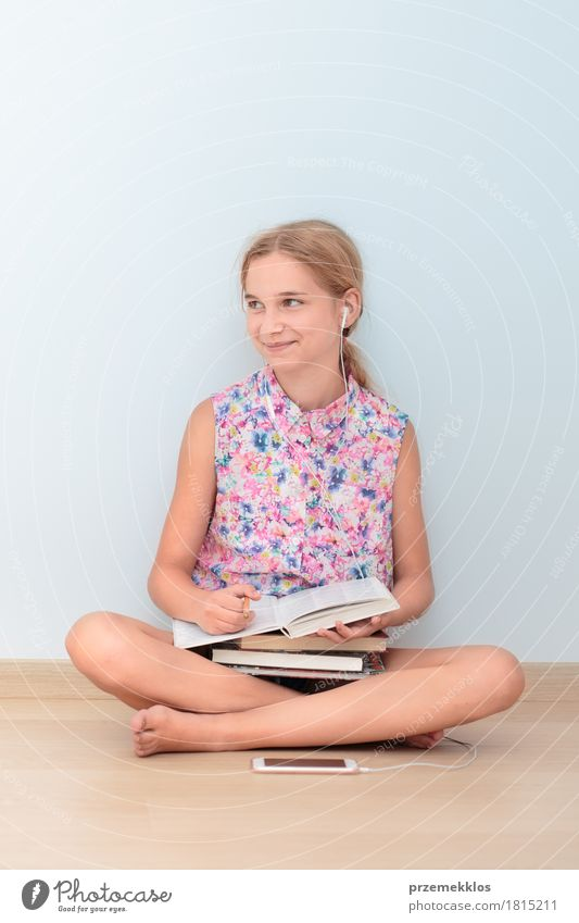 Schoolgirl reading a book in classroom Human being Girl Lifestyle Happy School Sit Book Academic studies Reading Education University & College student Cellphone Workplace Notebook Vertical Schoolchild