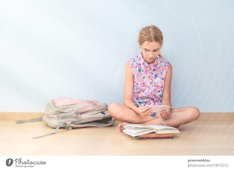Schoolgirl reading a book in classroom Lifestyle Reading Education Classroom Schoolchild Student Academic studies Cellphone Tool Girl 1 Human being