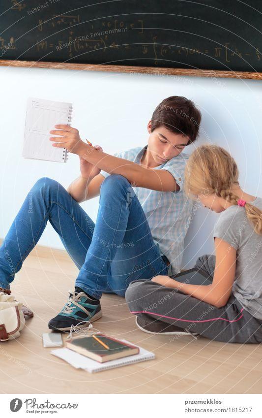 Teenagers sitting under a blackboard learning at school Education School Study Classroom Blackboard Schoolchild Student Academic studies