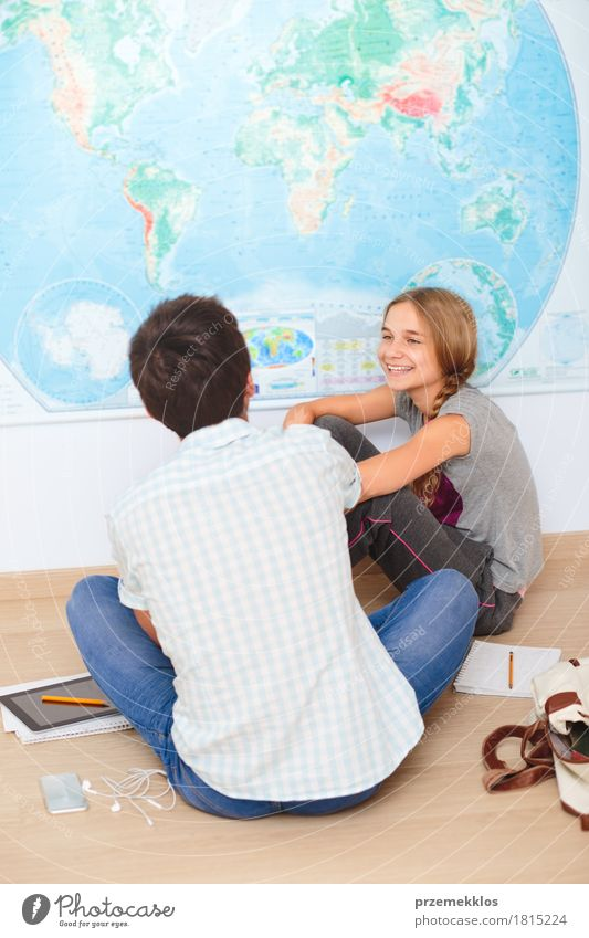 Teenagers sitting by the map in classroom Human being Youth (Young adults) Girl To talk Lifestyle Boy (child) School Think 13 - 18 years Sit Computer Book Study