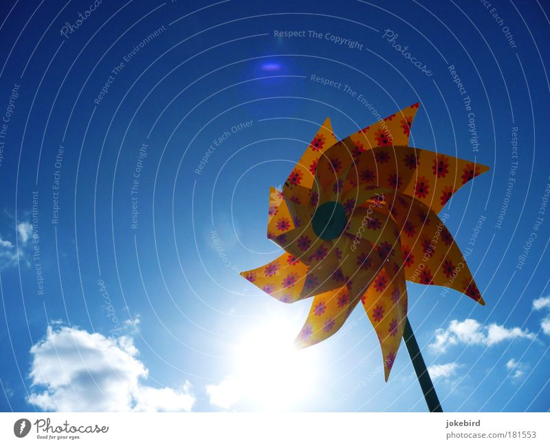 Sun on a stick Sky Clouds Beautiful weather Wind Toys Rotate Bright Blue Yellow Pinwheel Summer Climate Isolated Image Bright background Lens flare Blue sky
