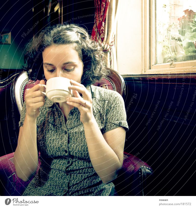 teatime Colour photo Interior shot Day Feminine Young woman Youth (Young adults) Woman Adults Relaxation Drinking Retro Safety (feeling of) Sadness Grief