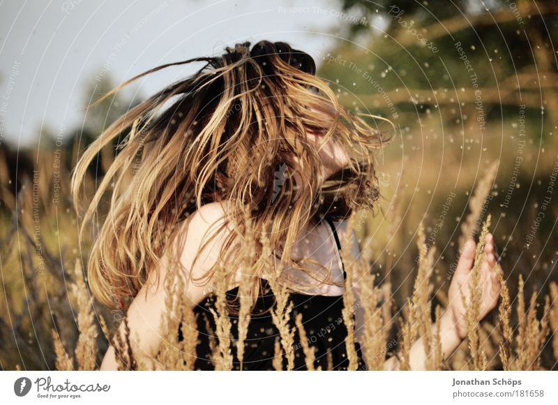 Dance in the field - woman shakes hair in the field Colour photo Exterior shot Light Sunlight Shallow depth of field Upper body Lifestyle Elegant Style Joy luck