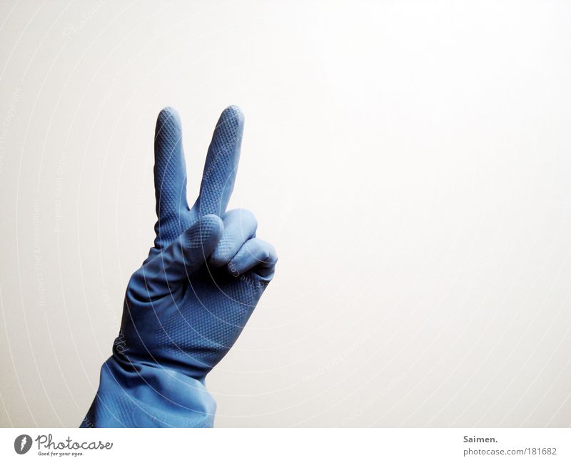 peace baby! Colour photo Subdued colour Interior shot Copy Space right Light Hand Fingers Joy Happy Peaceful Hope Blue Sign Gesture Symbols and metaphors Gloves
