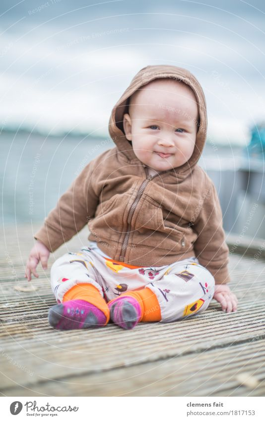 family happiness Baby Exterior shot Footbridge Water Family & Relations Child Sit Covered Brown Looking Innocent