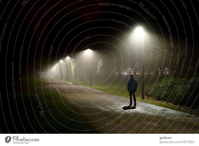 Lonely person goes on street in the dark night Night Loneliness Individual Fear Sadness Street Light Twilight Dark Mysterious Going Bright Young man Child Lamp