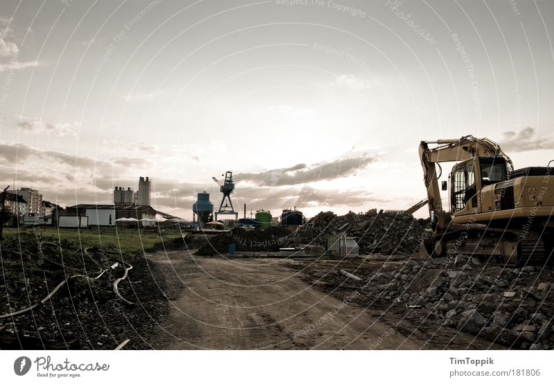 Excavating in the sunset Central perspective Panorama (View) Frankfurt Hesse Outskirts Deserted Industrial plant Factory Gloomy Construction site Excavator
