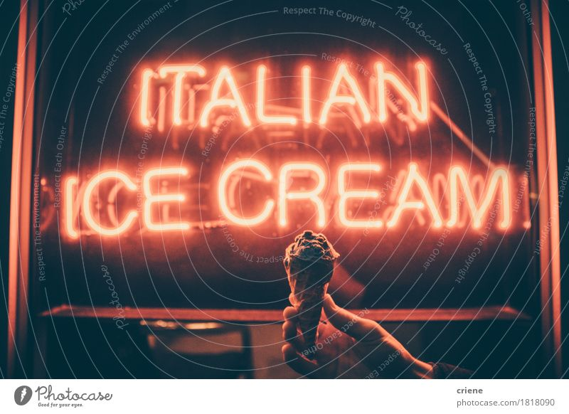 Board sign saying Italian Ice Cream with hand holding ice cream Summer Hand Eating Food Bright Ice cream Candy Dessert Text Carrying Hold Unhealthy Italian Dairy Products