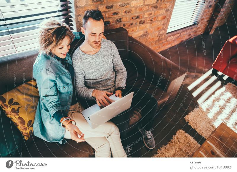 Son is showing his mother a picture on laptop Human being Man House (Residential Structure) Joy Adults Senior citizen Lifestyle Family & Relations Business School Together Modern Technology Smiling Mother Couch