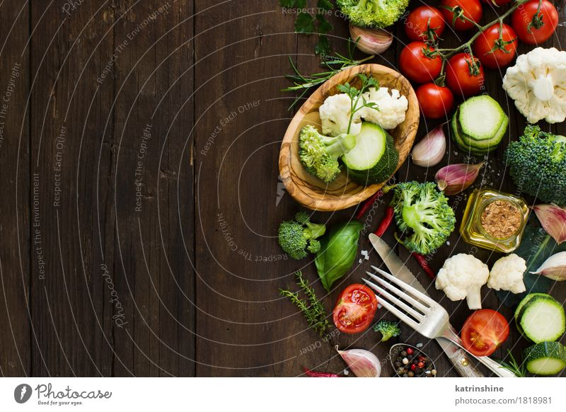Fresh vegetables on a wooden table Vegetable Herbs and spices Cooking oil Eating Vegetarian diet Diet Bowl Knives Fork Table Autumn Leaf Dark Natural Yellow