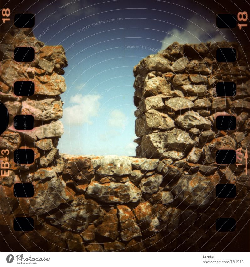 Permeable protective wall Clouds Summer Beautiful weather Moss Lichen Portugal Ruin Wall (barrier) Wall (building) Merlon Castle wall Stone Old Esthetic