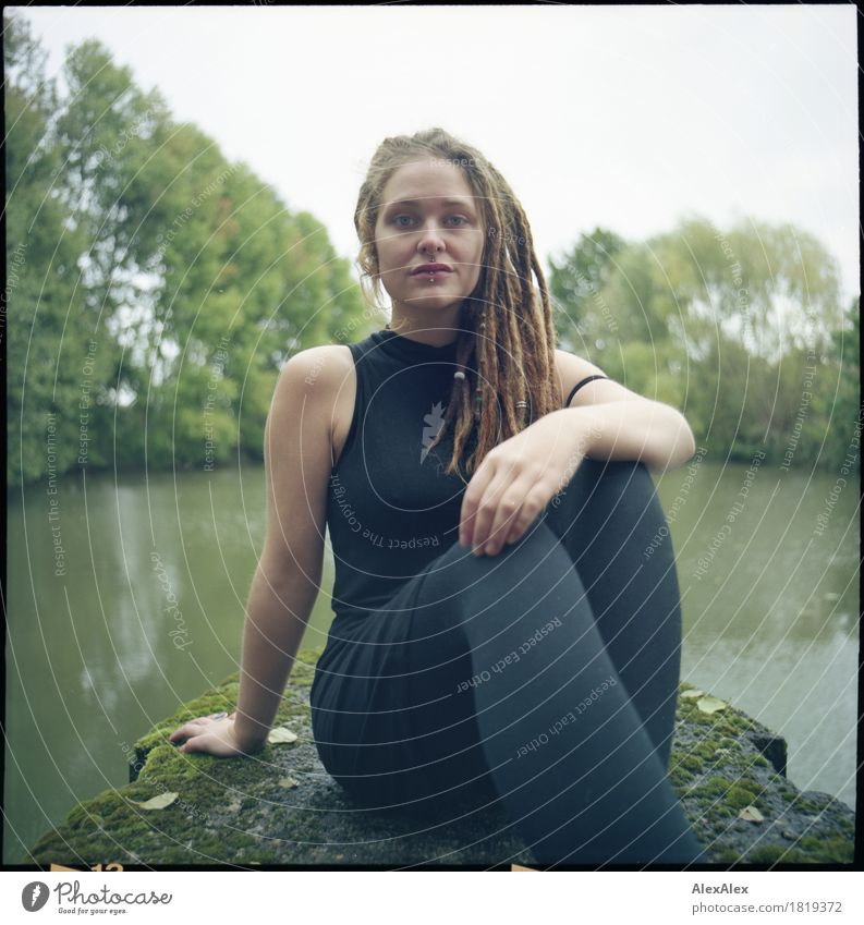definite Trip Adventure Young woman Youth (Young adults) Dreadlocks 18 - 30 years Adults Youth culture Nature Landscape Tree Lakeside Pontoon Concrete Dress
