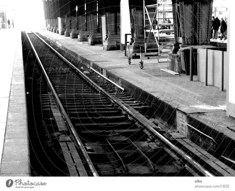 to nowhere Railroad tracks Train station Black & white photo Human being