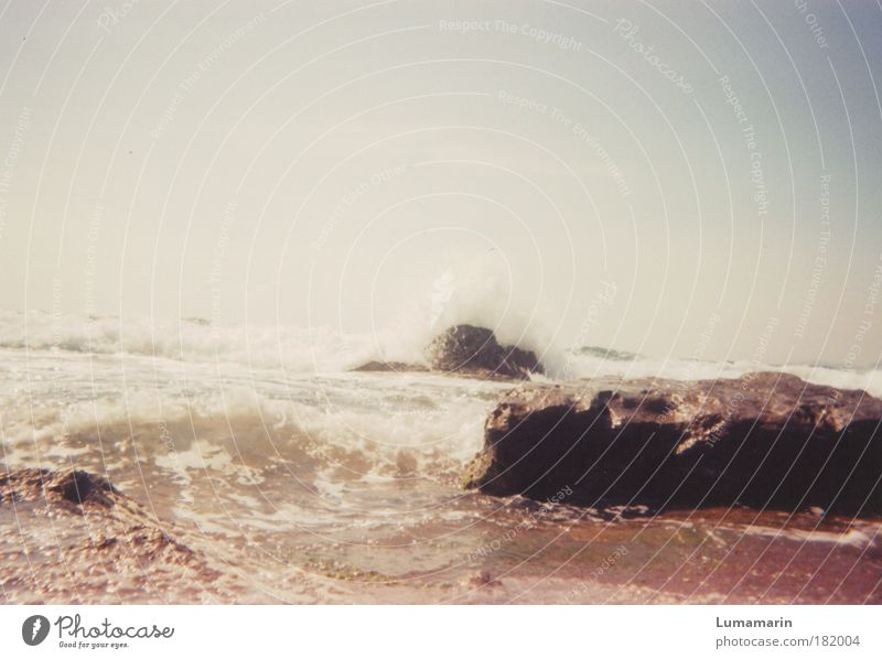 Rock in the surf Environment Landscape Elements Sand Water Sky Horizon Summer Beautiful weather Waves Coast Beach Ocean Near Warmth Wild Moody Life Longing
