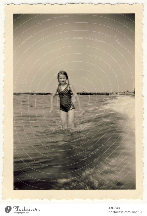 Summer 1937 Black & white photo Exterior shot Looking into the camera Swimming & Bathing Vacation & Travel Summer vacation Beach Ocean Waves Girl 8 - 13 years