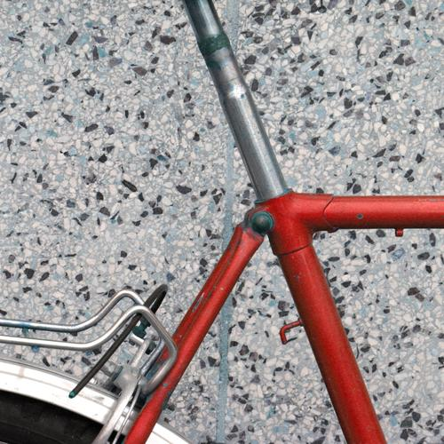 Companion Bicycle Red Axle welded Welding seam saddle post Concrete Concrete slab Corner Vehicle luggage carrier detail Exterior shot